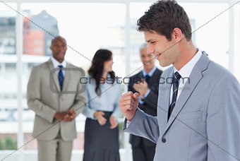 Young businessman using his fist to show his success