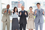 Business team showing success by putting their thumbs up