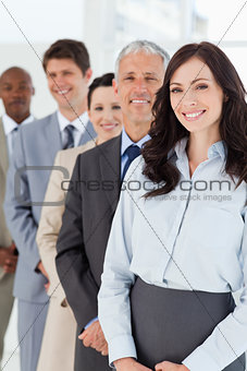 Smiling businesswoman looking confident while being followed by