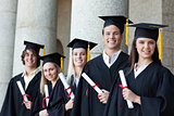 Portrait of graduates posing in single line