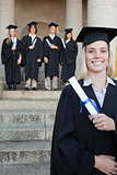 Close-up of a blonde graduate smiling