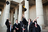 Graduates throwing their hats in the sky