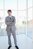 Stern businessman standing in a well-lit area