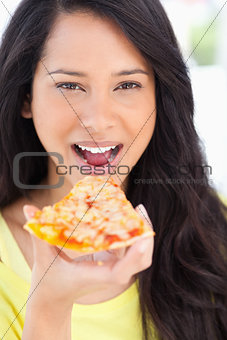 Close up  of a woman about to eat pizza