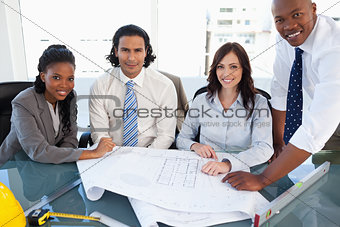 Smiling business team working on a project in a meeting room