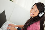 High-angle view of a smiling student using her laptop