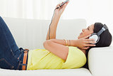 Young woman watching a video with earphones 
