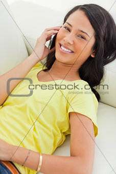 Portrait of a smiling Latino on the phone