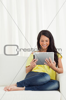 Beautiful smiling Latino looking a touch pad