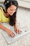Close-up of a smiling Latin chatting on a laptop