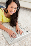 Portrait of a smiling Latin chatting on a laptop