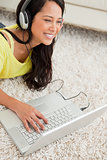 Close-up of a happy Latin chatting on a laptop