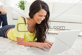Beaming Latin woman using a laptop