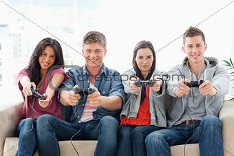 A group with arms out smiling as they play games together