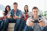 A group of friends playing games while looking at the camera