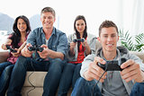 A happy group of friends playing games together while looking at