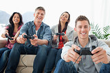 Laughing group of friends in front of the camera as they play ga