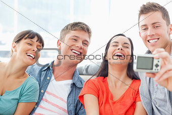 A laughing group pose for a funny photo