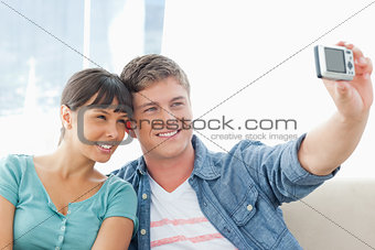 A smiling couple pose together for a photo