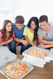 A group of friends about to eat pizza