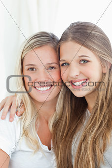 Close up of a smiling pair of sisters