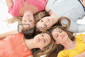 Four girls sleeping on the floor together