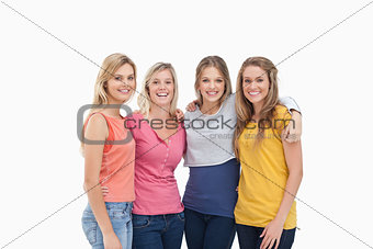 Four friends standing beside each other and smiling