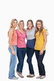 Full length of four girls standing beside each other and smiling