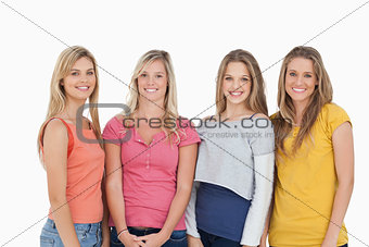 Four girls smiling as they look at the camera