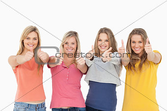 Girls sticking their thumbs up