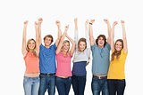 Smiling people raising hands up in the air