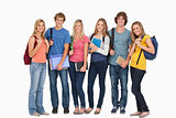 Smiling students wearing backpacks and holding books in their ha