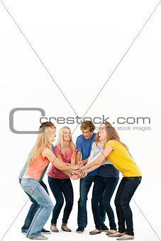 Group of friends about to cheer with their hands stacked