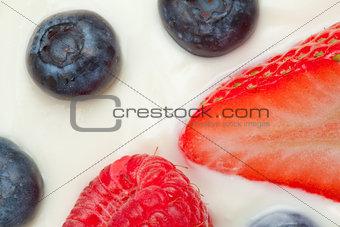 Slice berries on the cream