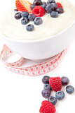 Different berries cream with a tape measure