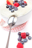 Berries cream and spoon with a tape measure