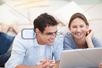Young Couple watching a computer
