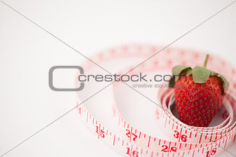 Strawberry surrounded by a ruler