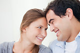 Couple smiling while touching forehead