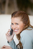 Woman smiling while phoning 