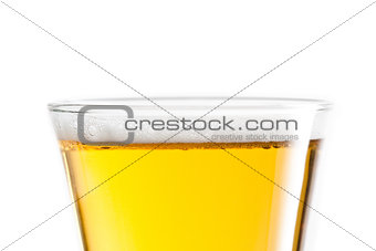 Top of a glass of beer against a white background