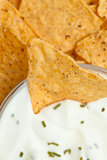 Close up of a bowl of white dip with herbs
