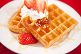 Waffles with whipped cream and strawberries