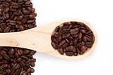 Wooden spoon with coffee seeds