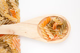 Wooden spoon with pasta
