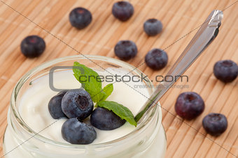 Close up of many blueberries in a pot of yogurt