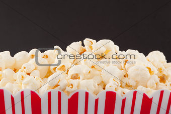 Close up of a top of a box full of pop corn
