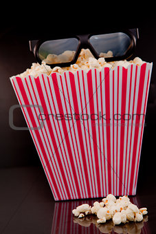 3D glasses on a box of pop corn