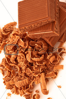 Close up of pile of chocolate pieces and chocolate shavings