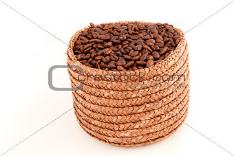 A basket full of roasted coffee seeds
